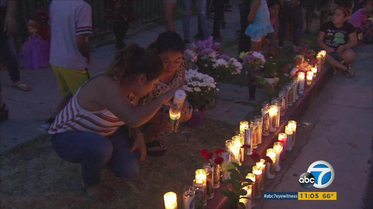 Friends and community members lit candles on Sunday, Aug. 21, 2016, to honor a mother and her two daughters who were killed by a suspected drunk driver in Placentia.