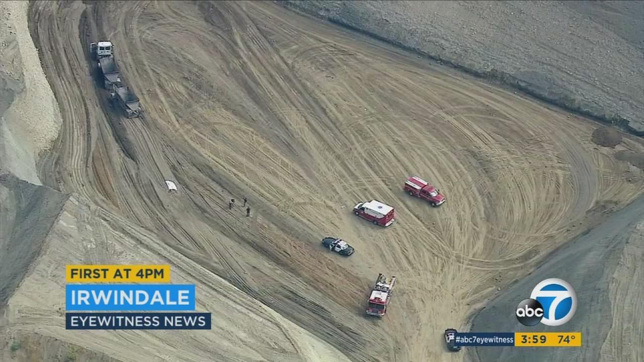 An investigation is underway at an Irwindale landfill site after a mans body was discovered at the bottom of a dirt pit Friday.