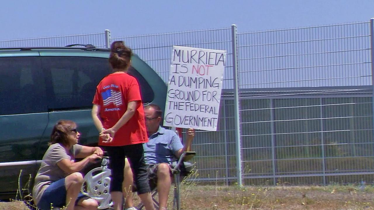 Protesters are seen outside the border patrol station in Murrieta on Monday, June 30, 2014.