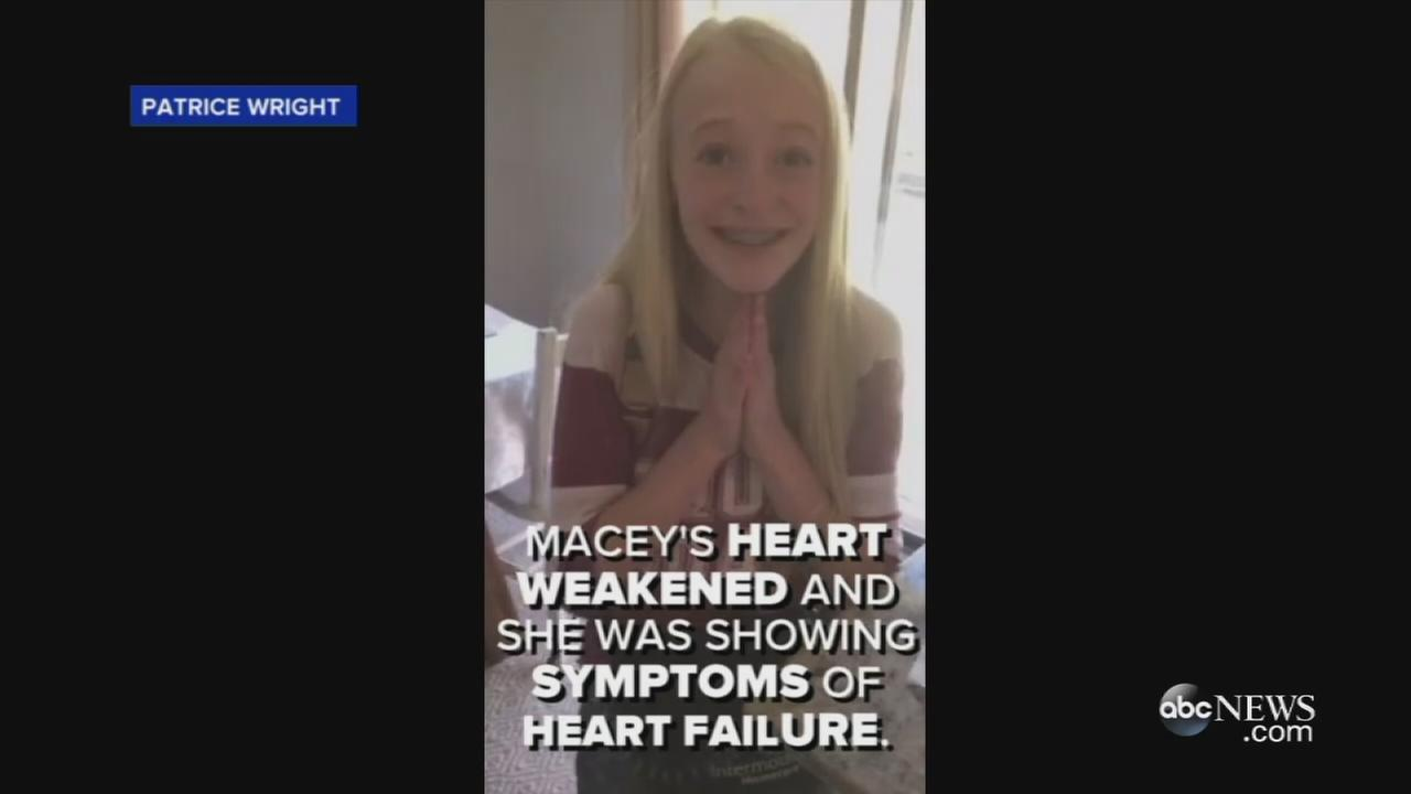 Macey Wright is seen smiling in a frame from a video taken by her mother after being told she would receive a new heart.