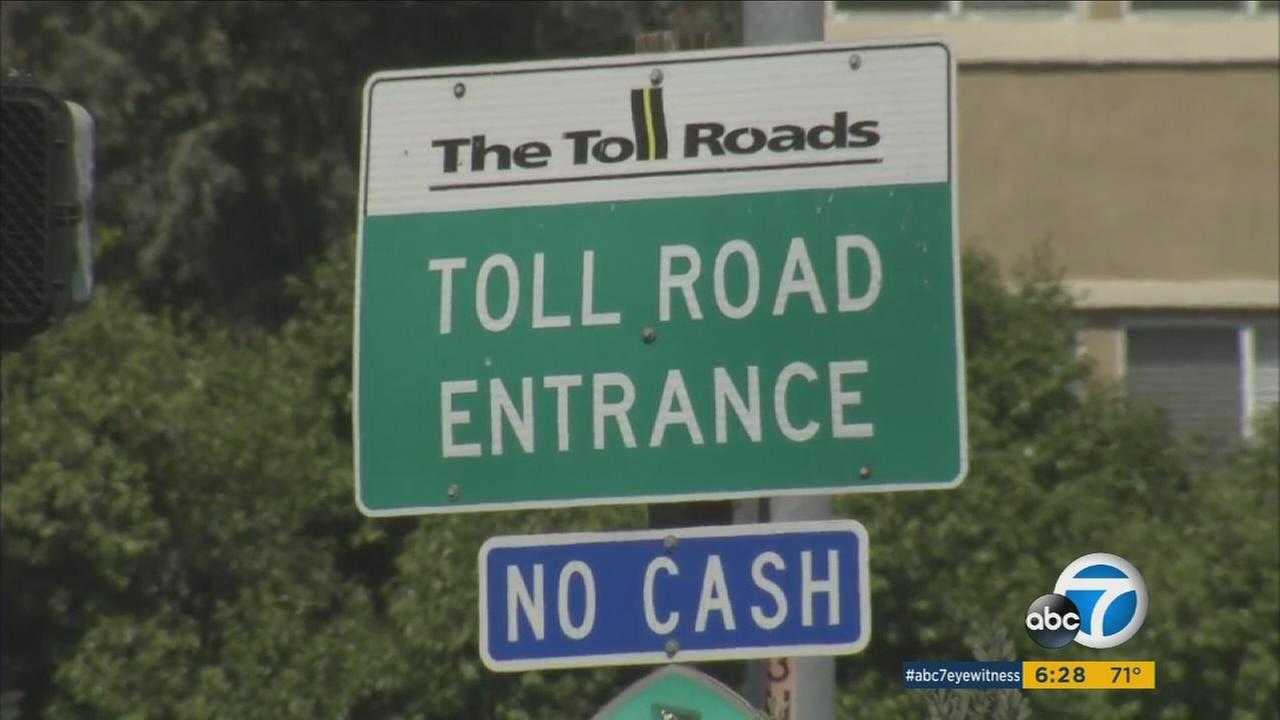 A toll road sign is shown in an undated photo.