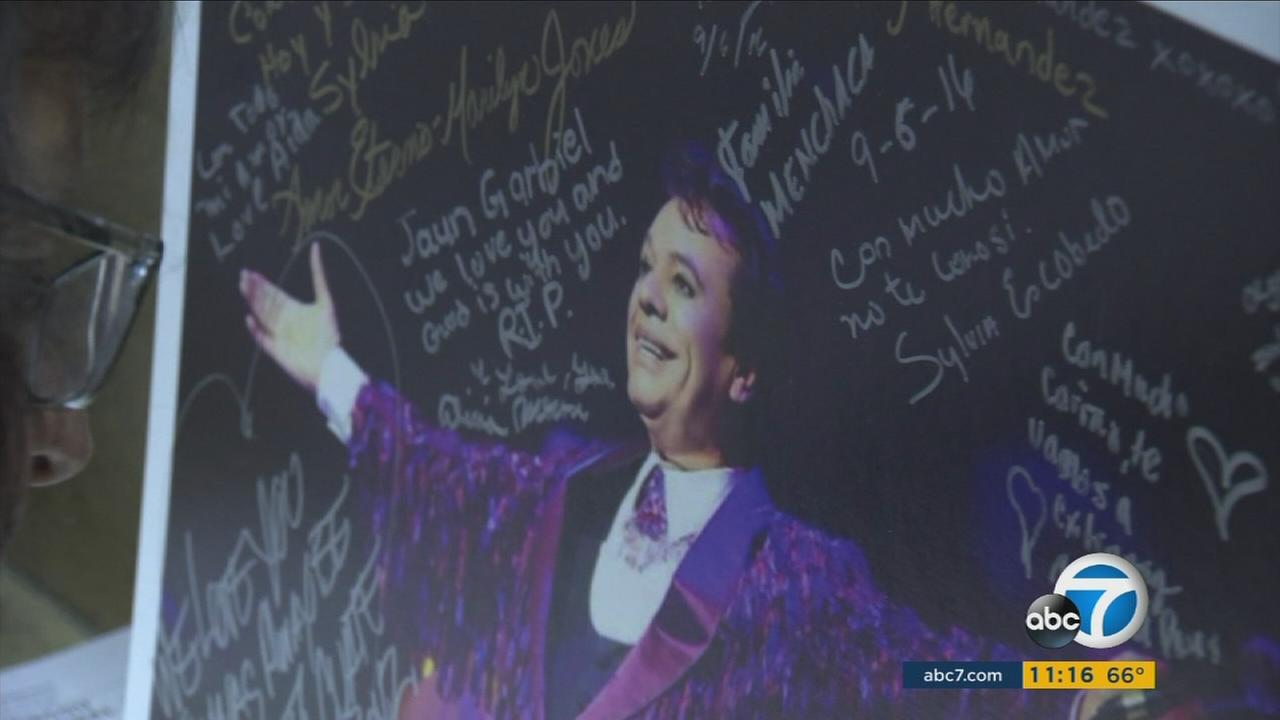 Dozens of fans signed Juan Gabriel posters as they honored the late singer-songwriter at a Monterey Park church on Tuesday, Sept. 6, 2016.