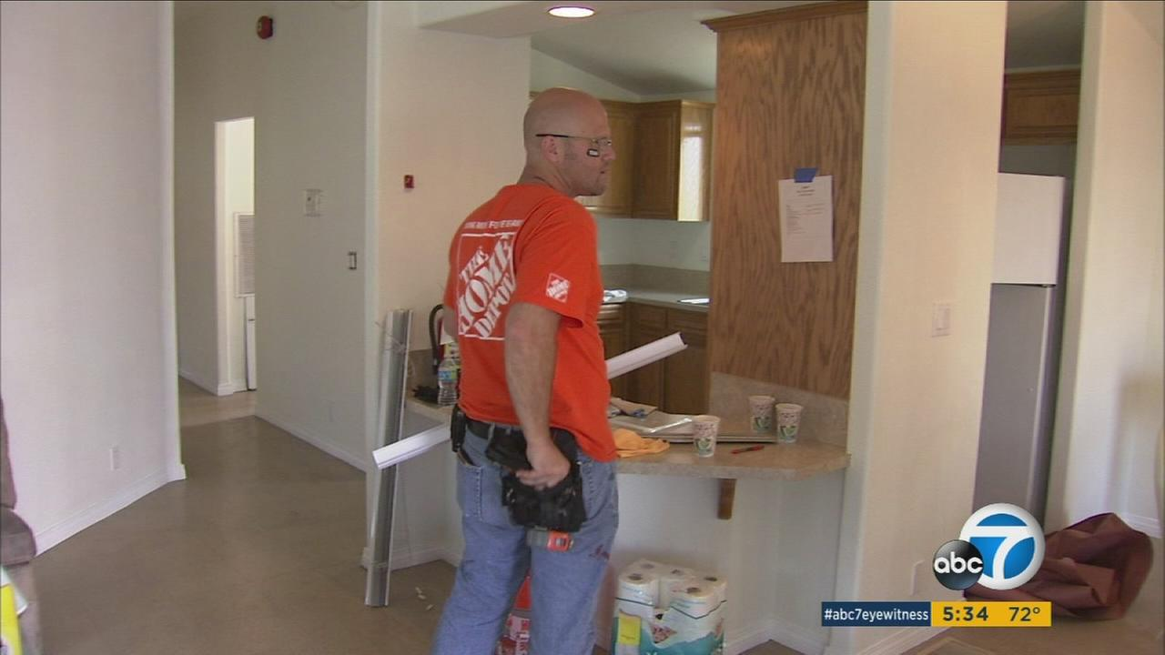 A Home Depot volunteer is shown doing renovations to a portion of a homeless veteran shelter in Bell.