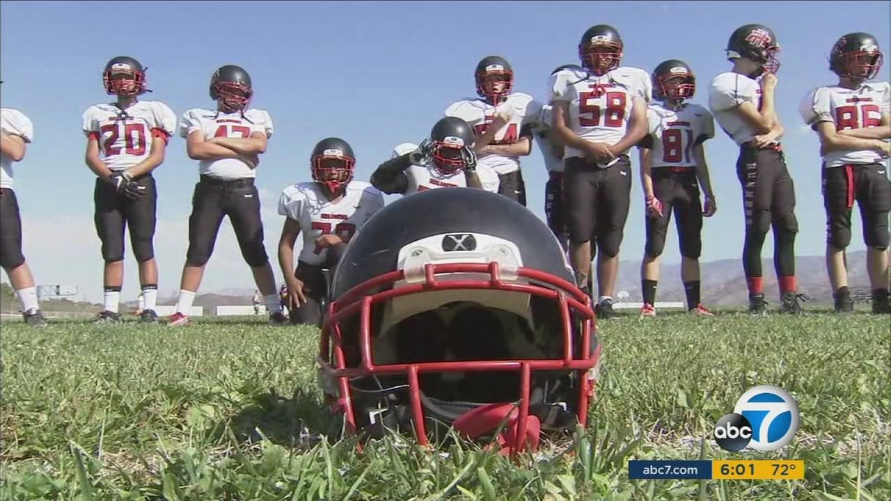 A day after their teammate died in a gun accident, the Rosamond High School Roadrunners took the field in tribute to the fallen star running back.