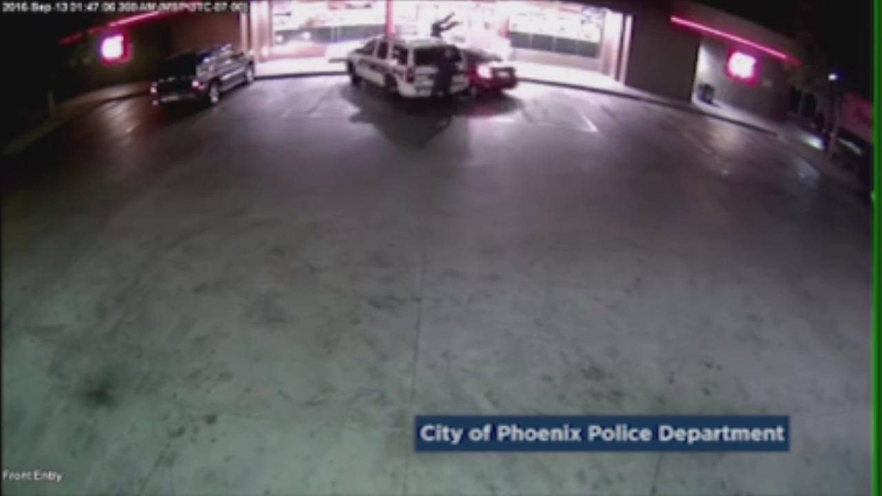 Authorities said a man intentionally crashed his car into three Phoenix police officers at a gas station on Tuesday, Sept. 13, 2016.