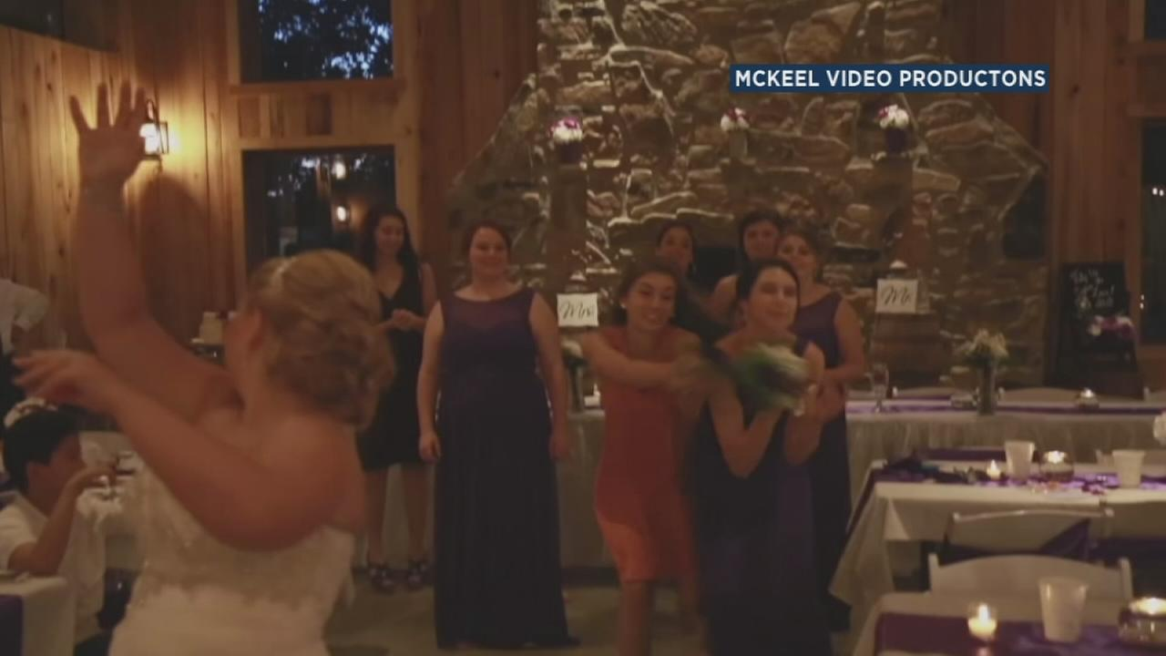 The battle for a brides bouquet got brutal as bridesmaids and guests went for the flowers at a wedding in Melber, Ky., on Aug. 28, 2016.