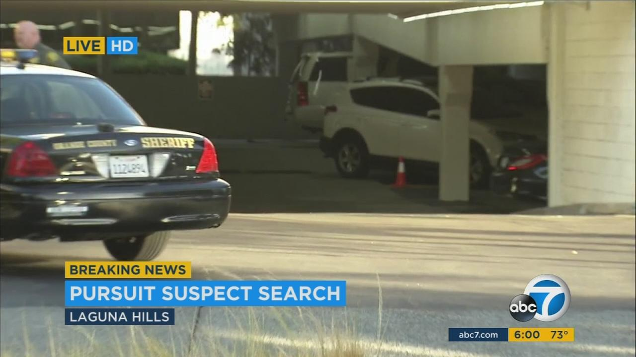 Police surrounded Saddleback Memorial Medical Center in Laguna Hills after two suspects ditched their stolen SUV in a parking structure and fled Thursday, Sept. 15, 2016.