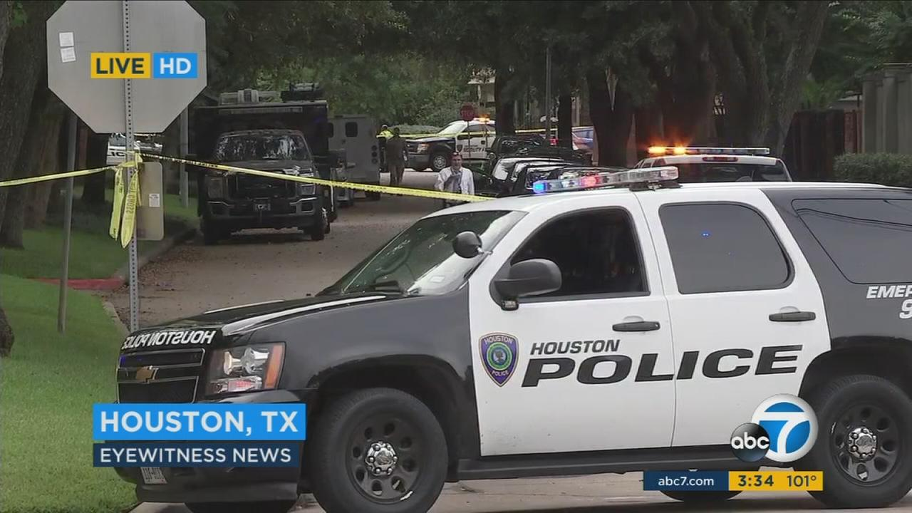 Houston patrol vehicles surround the scene of a mass shooting on Monday, Sept. 26, 2016.