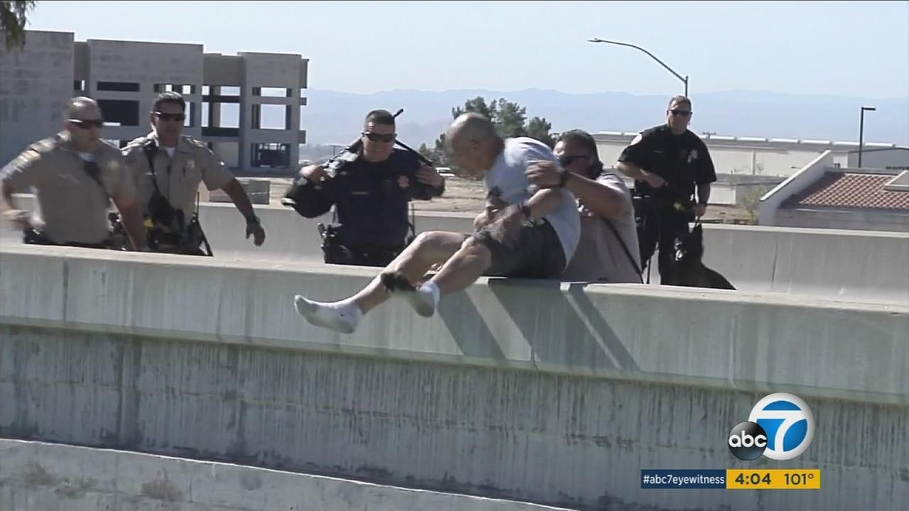 A chase suspect was pulled from a ledge on a 215 Freeway overpass in San Bernardino on Monday, Sept. 26, 2016.