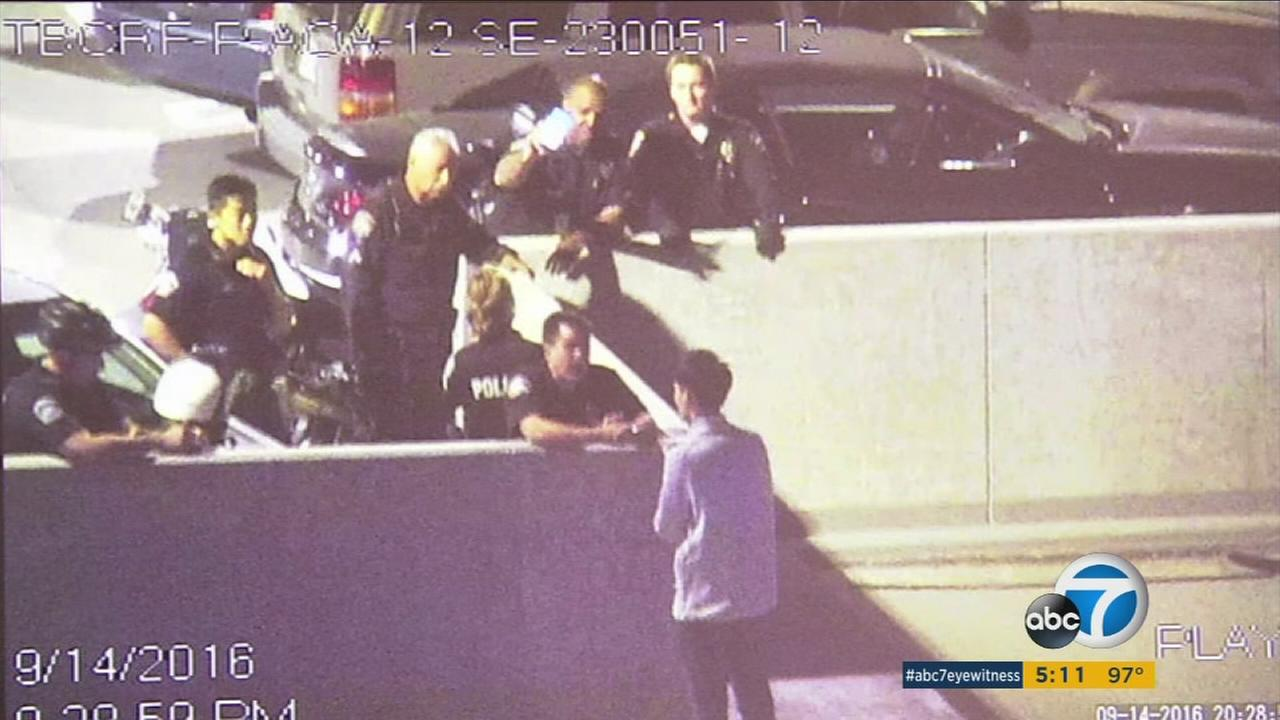 Surveillance video shows LAX officers talking to a man who was contemplating committing suicide by jumping from a parking garage.