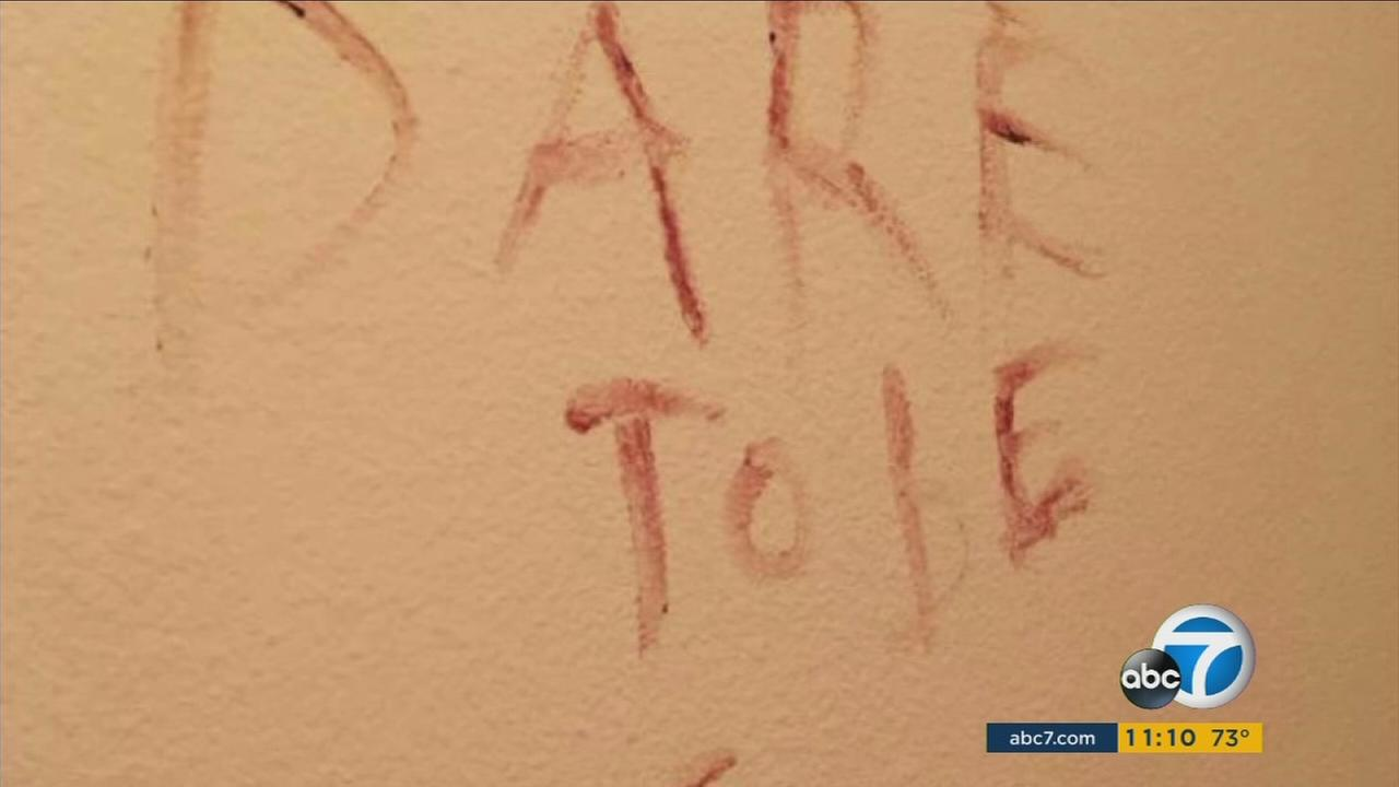 Words written on walls possibly with a suspects blood near Exposition Park on Tuesday, Sept. 27, 2016.