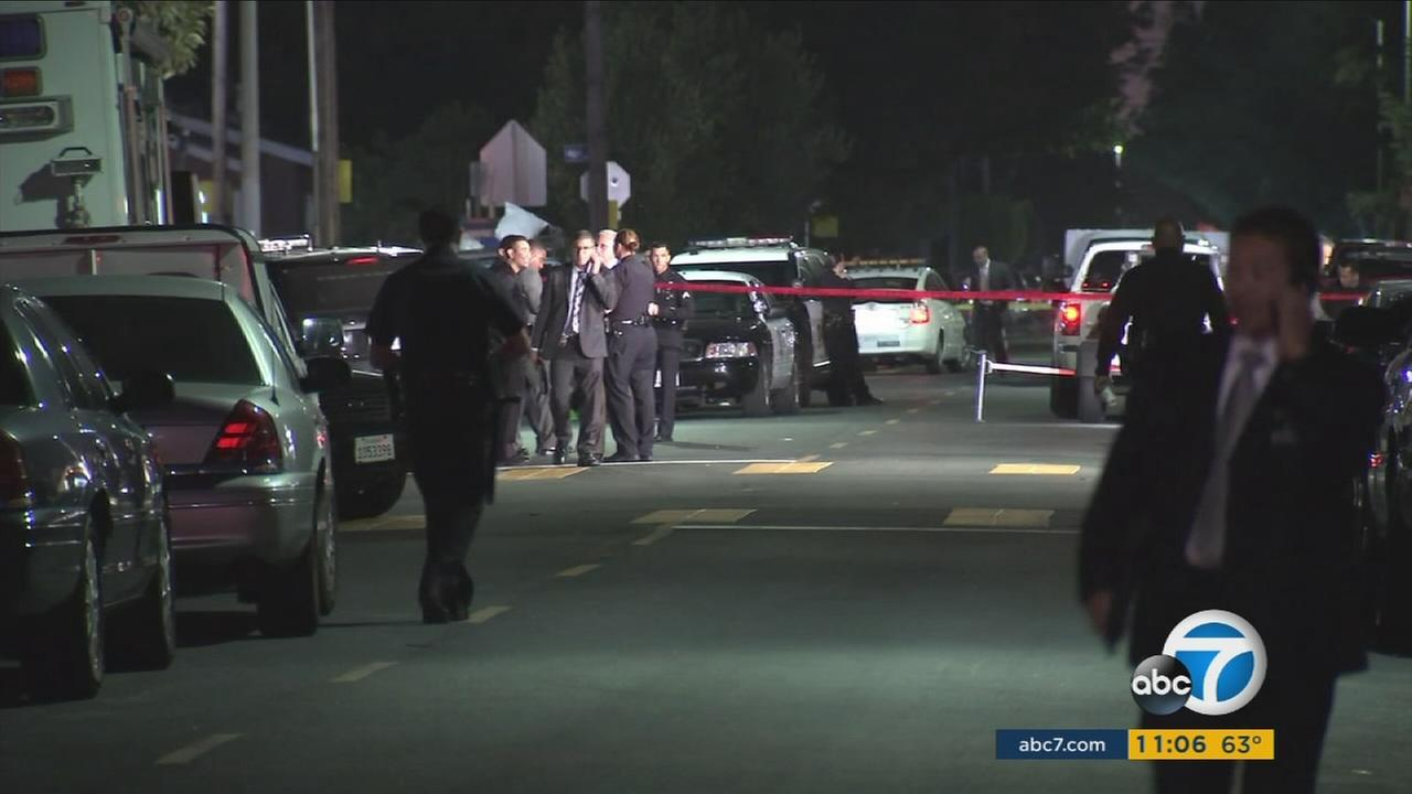 Authorities investigate the scene of a fatal officer-involved shooting in South Los Angeles on Sunday, Oct. 2, 2016.