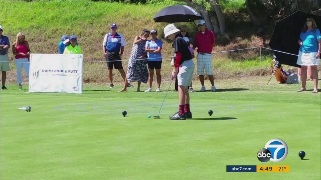 Liam Hartling, 10, is shown playing golf at a drive, chip and putt tournament in Los Angeles.