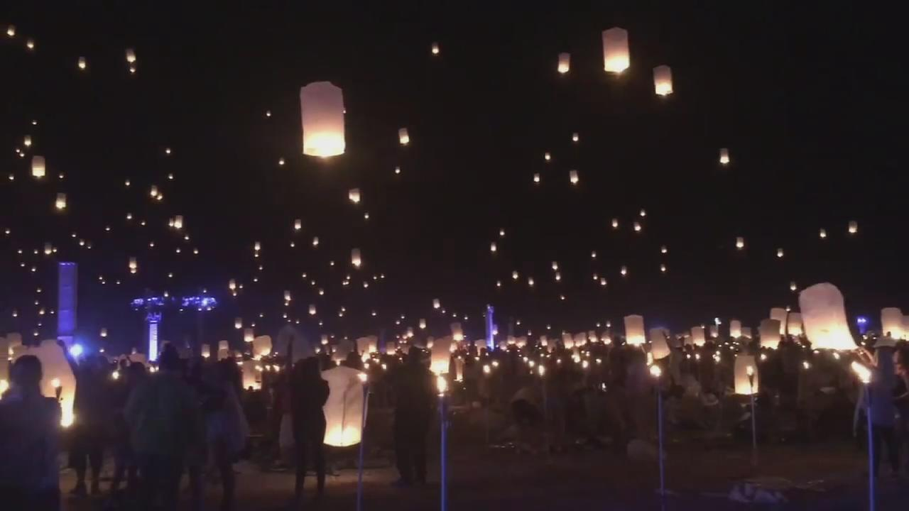 Lanterns float into the night sky in the desert near Las Vegas during the RiSE Lantern Festival on Saturday, Oct. 8, 2016.