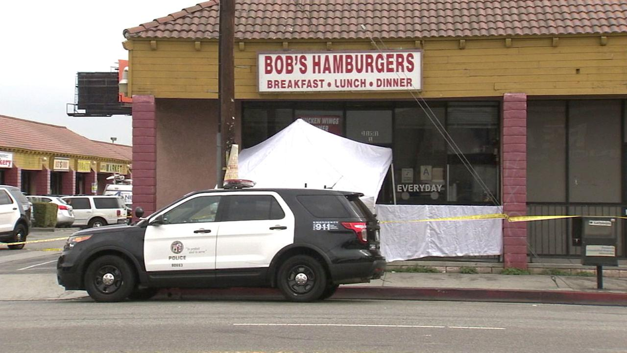Authorities blocked off the front of Bobs Burgers in Harbor City after two people were shot and killed on Wednesday, Oct. 12, 2016.