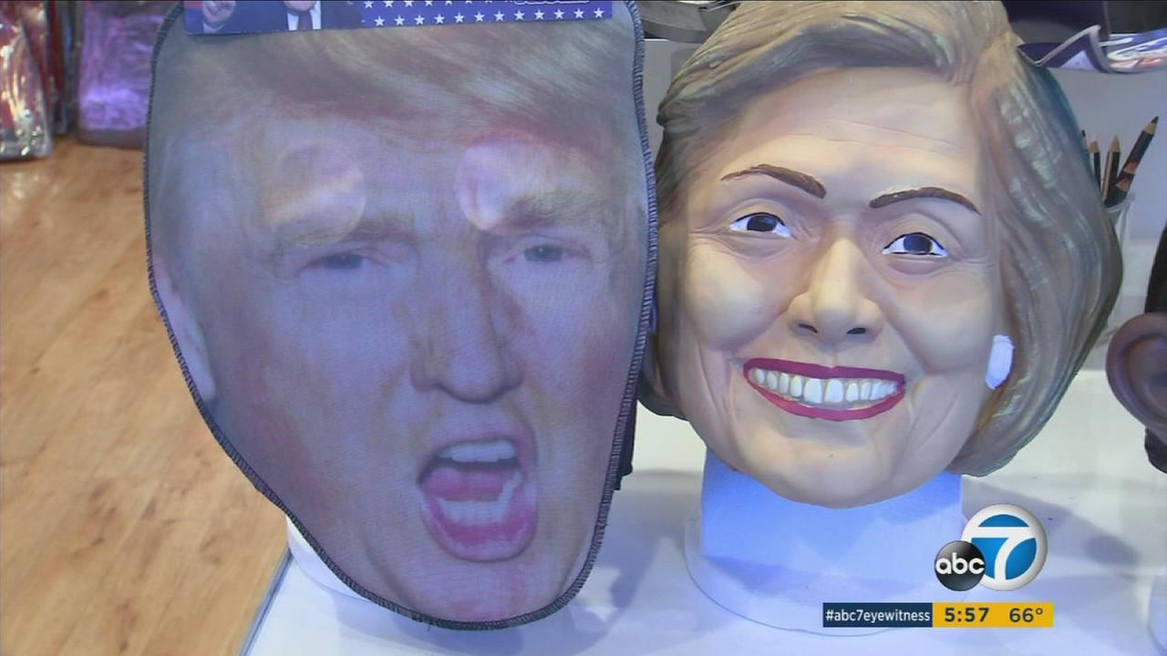 Hillary Clinton and Donald Trump masks are shown inside a Burbank costume shop.