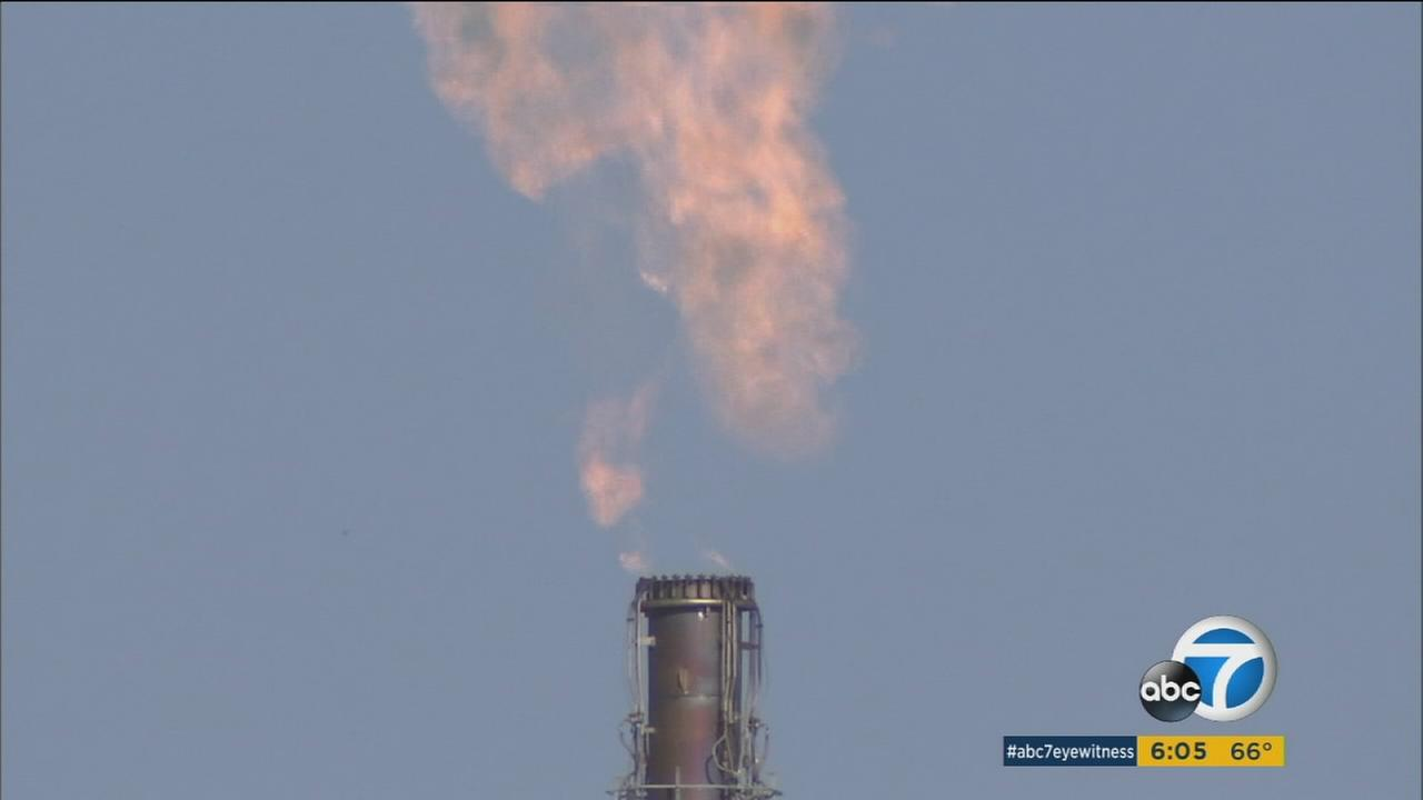 Flaring is seen from a Torrance refinery a day following a large power outage in the South Bay area.