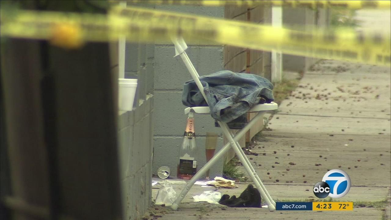A bloody scene is shown in the front of a home makeshit restaurant at a home in the West Adams area of Los Angeles on Saturday, Oct. 15, 2016.