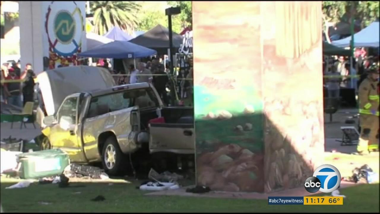 A crushed pickup truck is shown in a park below the Coronado Bridge in San Diego after the driver crashed on Saturday, Oct. 15, 2016.