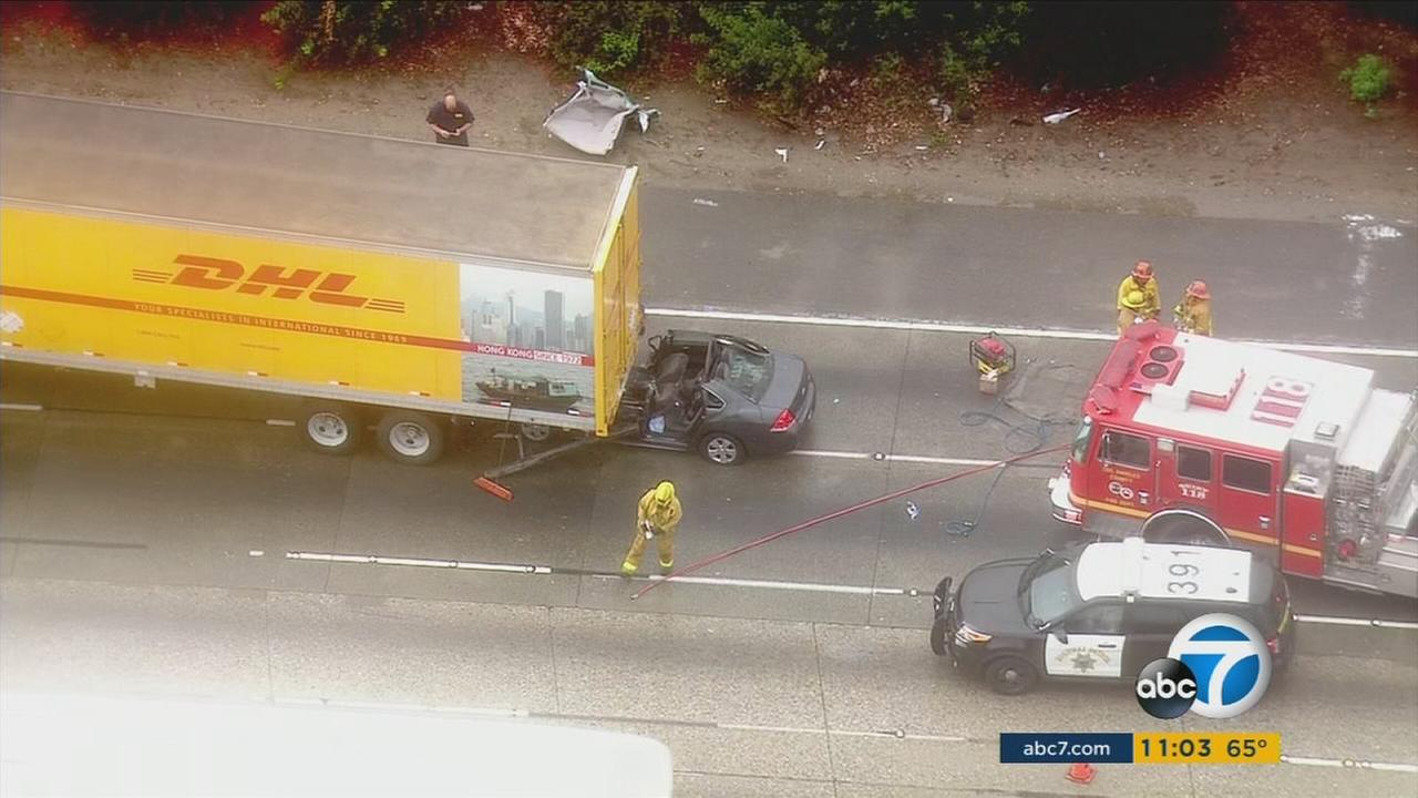 Southern California drivers were confronted with slippery, wet roads throughout the morning on Monday, causing several car wrecks and risky driving conditions.