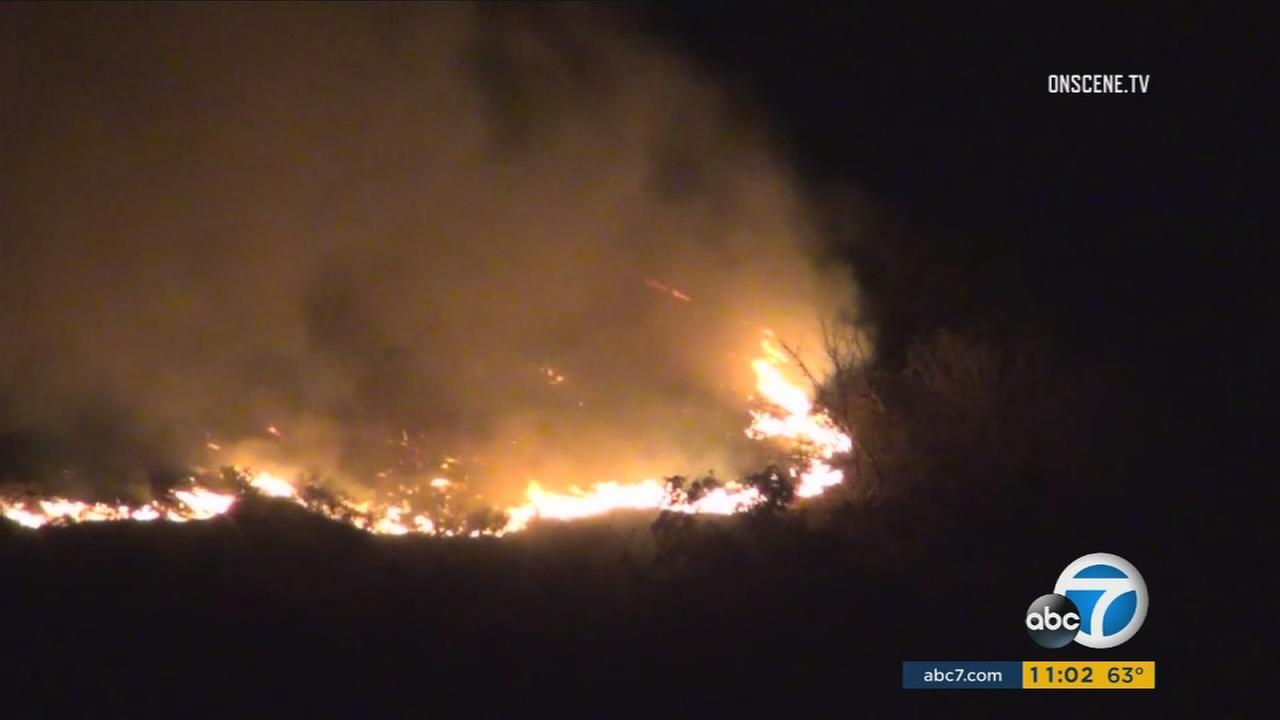Firefighters battled a 15-acre brush fire burning in the hills of Porter Ranch Tuesday night.