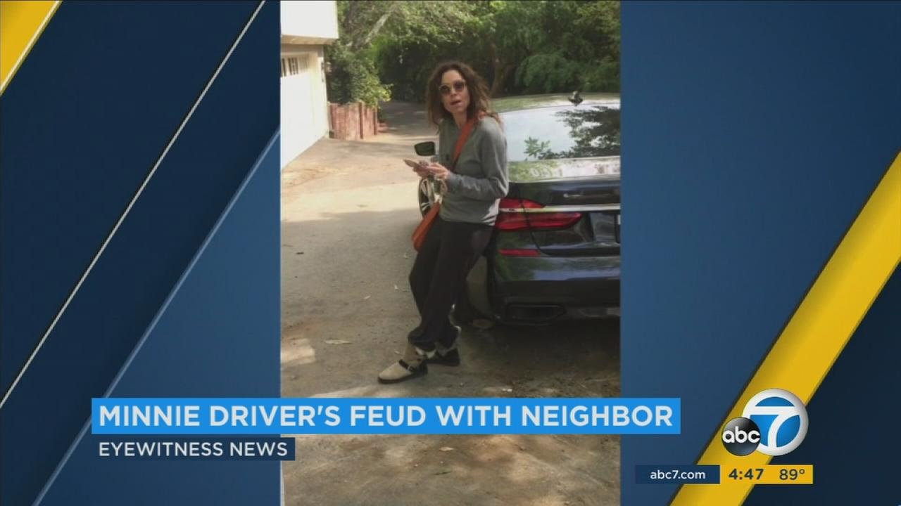 Actress Minnie Driver is having a legal dispute with her Hollywood Hills neighbor, who captured one of their arguments on camera.