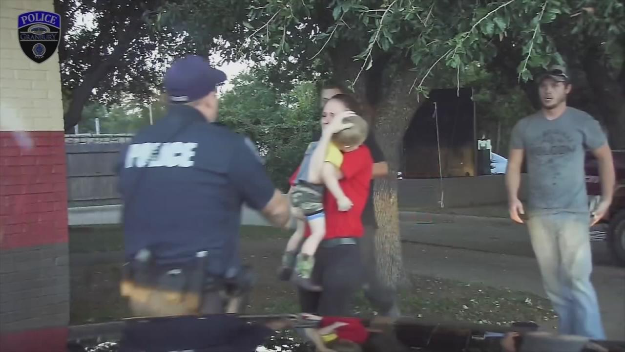 Officer Chase Miller of Granbury, Texas, is shown arriving to help a 3-year-old boy who was unresponsive on Wednesday, Oct. 12, 2016.