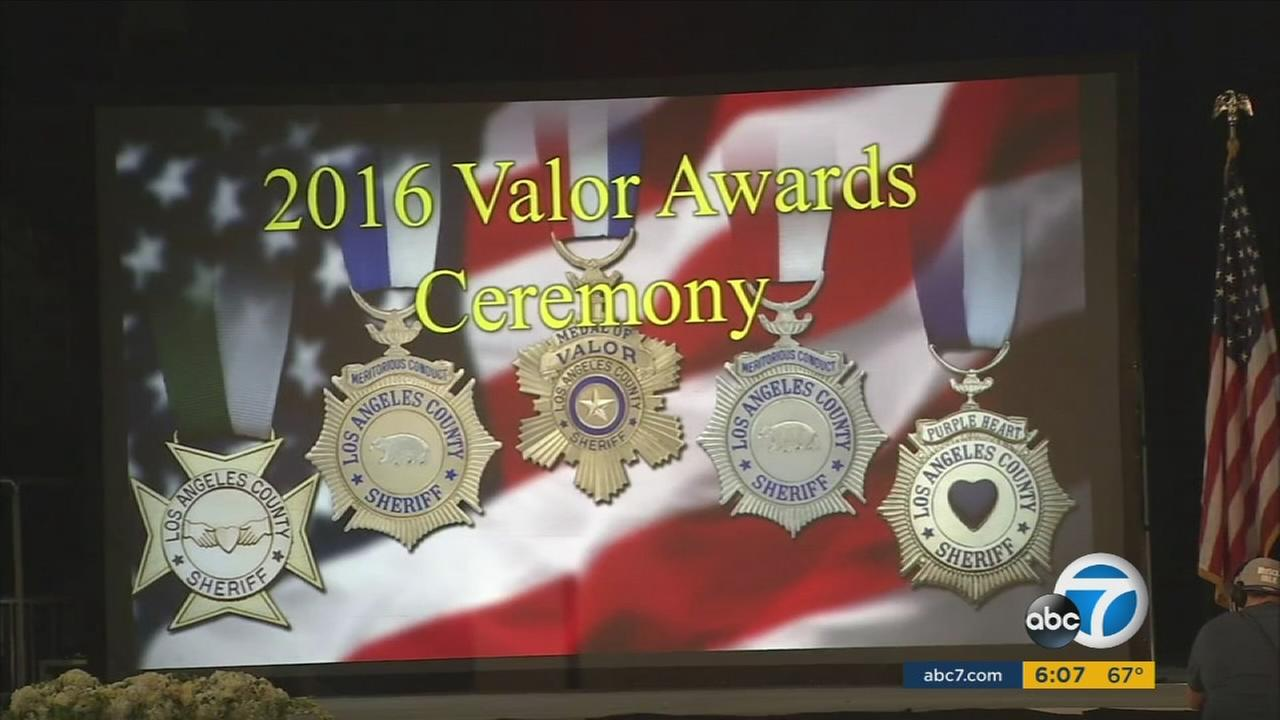 Members of a Los Angeles County Sheriffs Department SWAT team were honored with the agencys Medal of Valor for taking down an armed gunman who held restaurant diners hostage in Downey last year.