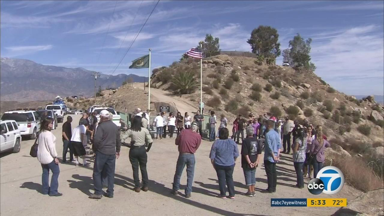Loved ones of the crew for Engine 57, who perished in the Esperanza Fire, came together 10 years later for a moment of silence.