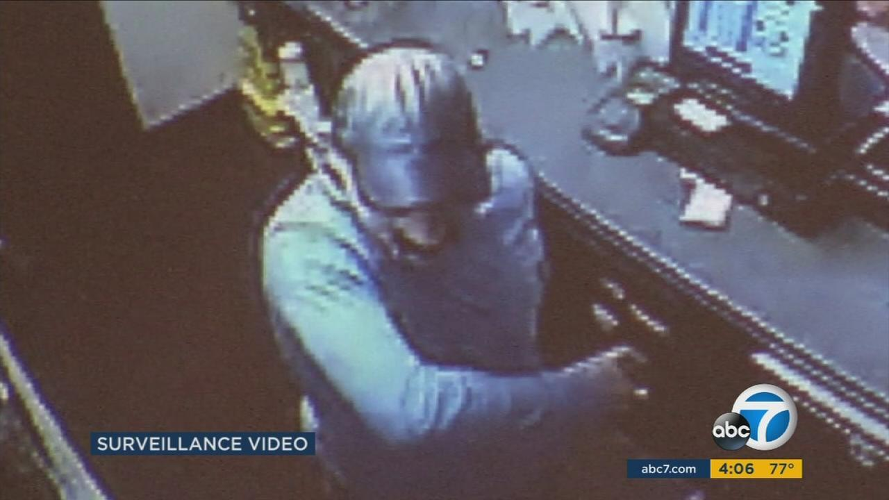 Surveillance video shows a masked gunman opening fire and killing Juan Vidal, 25, a cashier at an El Monte Jack in the Box.