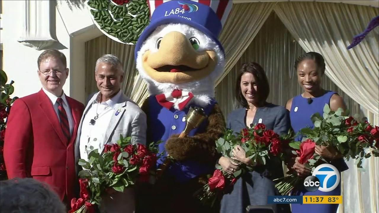 Olympians Allyson Felix, Greg Louganis and Janet Evans pose for a photo after they were announced as the grand marshals of the 2017 Rose Parade.