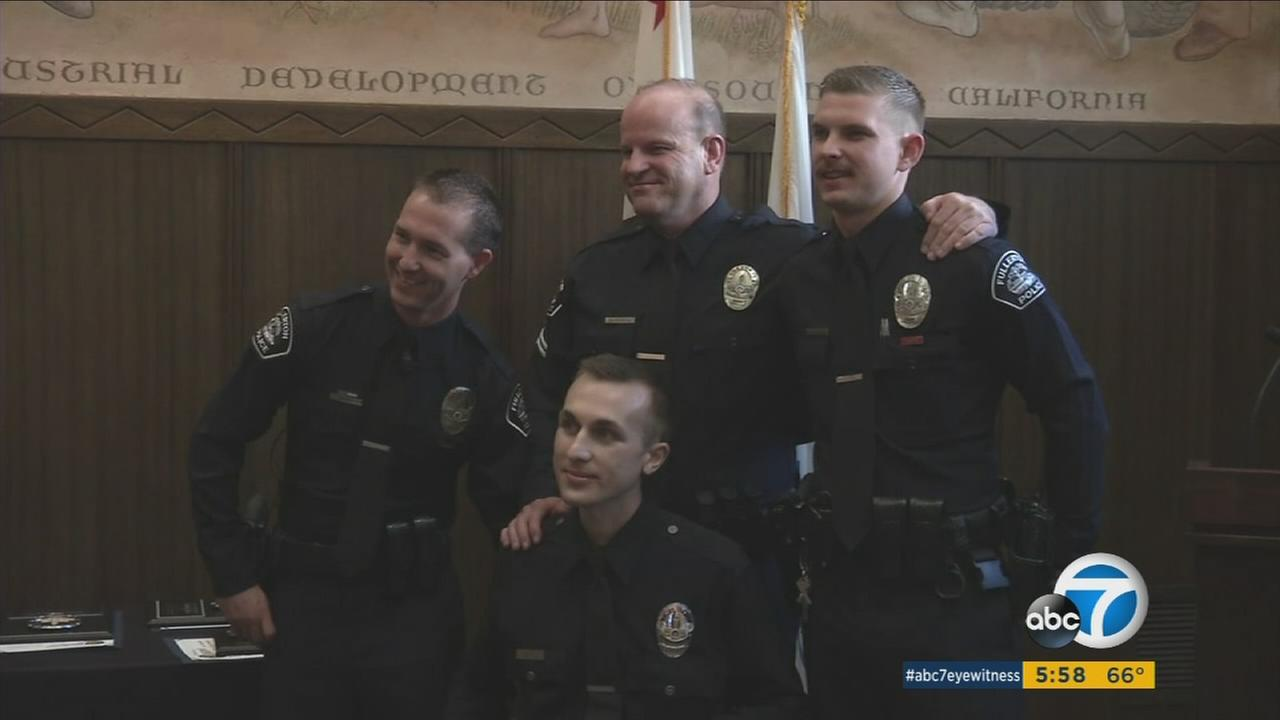 Officer Nicholas Wiltz (below) with the Los Angeles Police Department meets the Fullerton officers who saved his life after a motorcycle crash on Aug. 22, 2016.