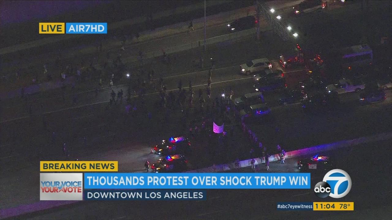 Thousands of demonstrators gathered in downtown Los Angeles late Wednesday to protest the election of Donald Trump, spilling out past city streets to block traffic on the 101 Freeway.
