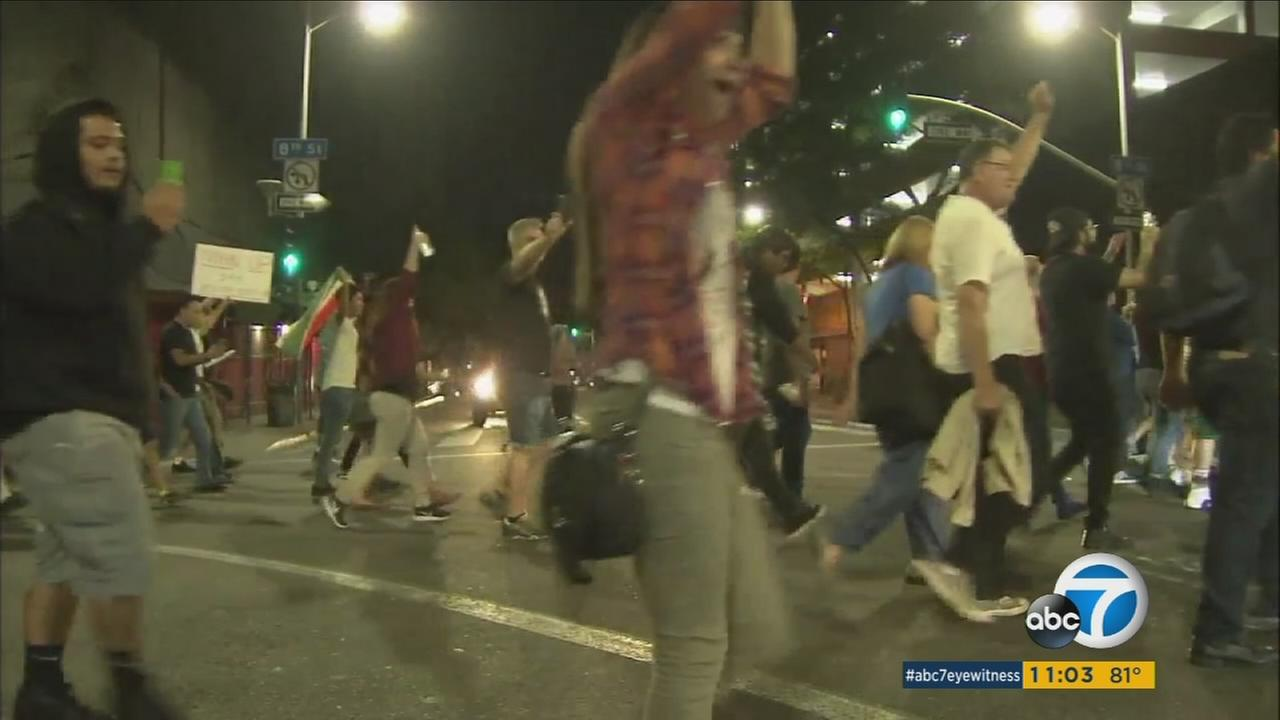 Several anti-Trump protesters walk the streets of downtown Los Angeles after the billionaire businessman won the presidential election.