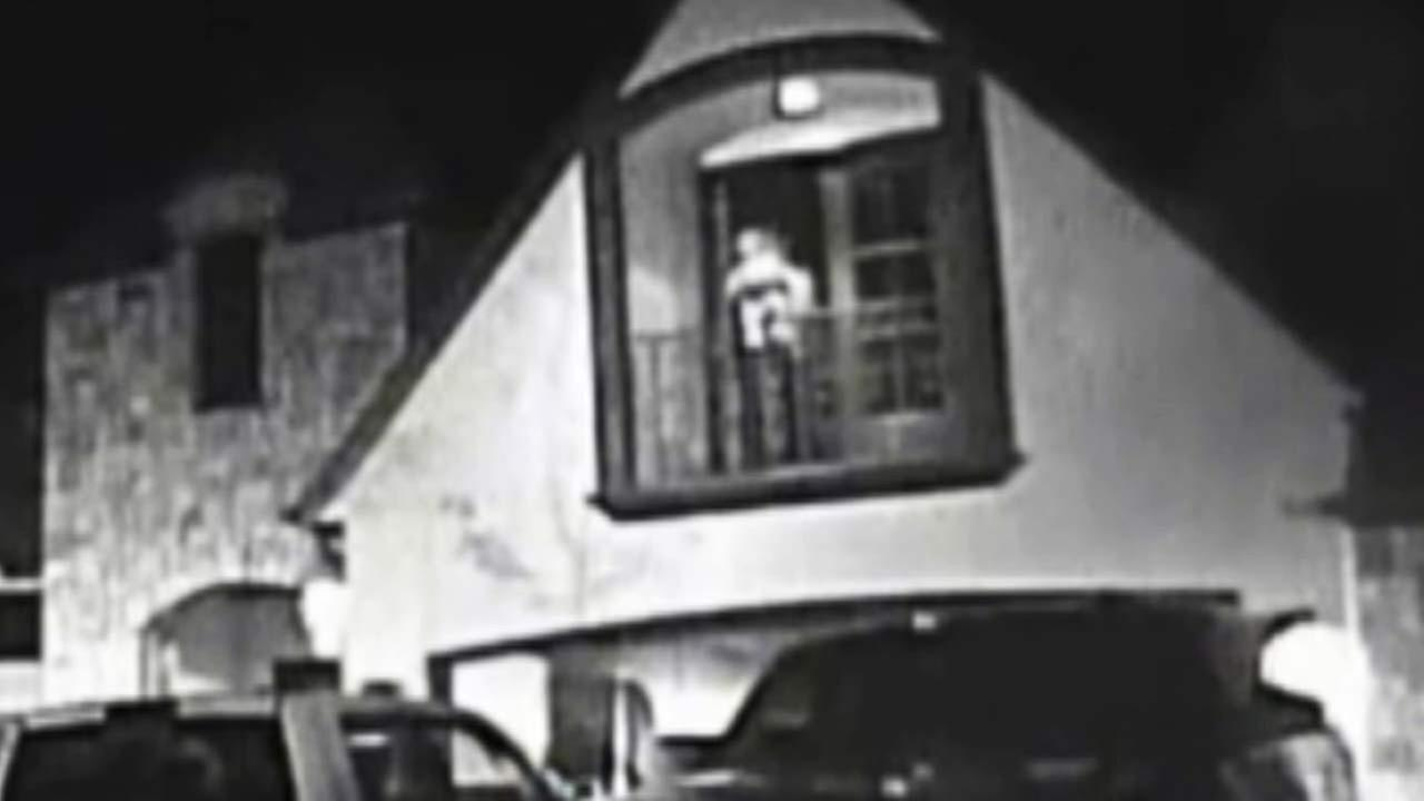 A man is seen holding a toddler on the balcony of a home in Tulsa, Oklahoma, on dash cam footage released by police.