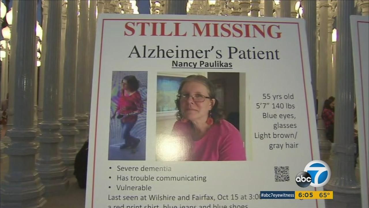 A poster at the Los Angeles Museum of Art shows information of missing woman Nancy Paulikas, who suffers from Alzheimers disease.