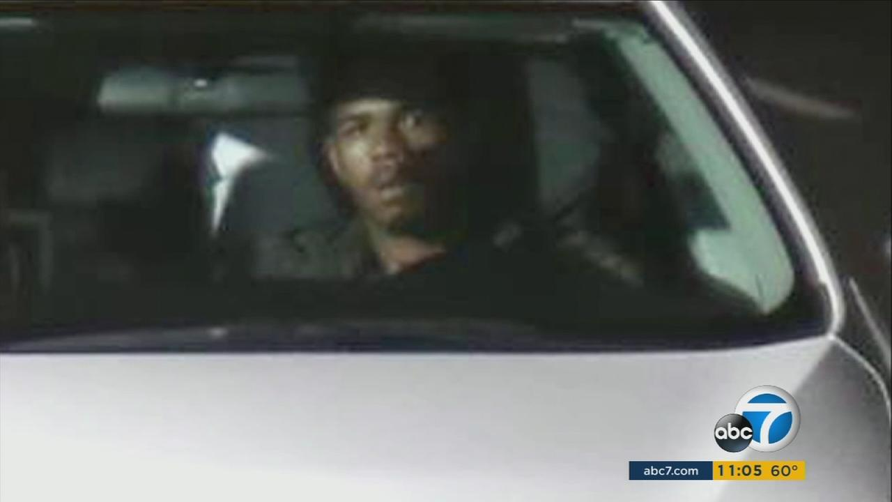 A photo shows a stolen car suspect in the victims car after the suspect was caught on a red-light camera.