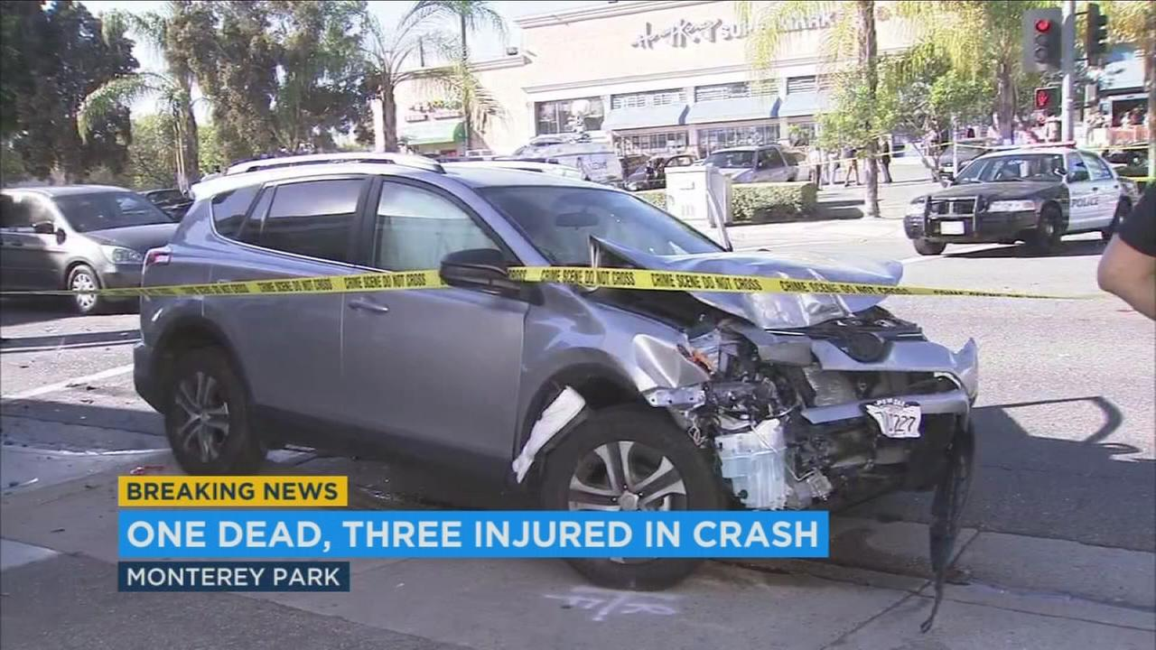 Part of an SUV is seen crumbled after the driver allegedly struck three pedestrians, killing one, on Friday, Nov. 18, 2016.
