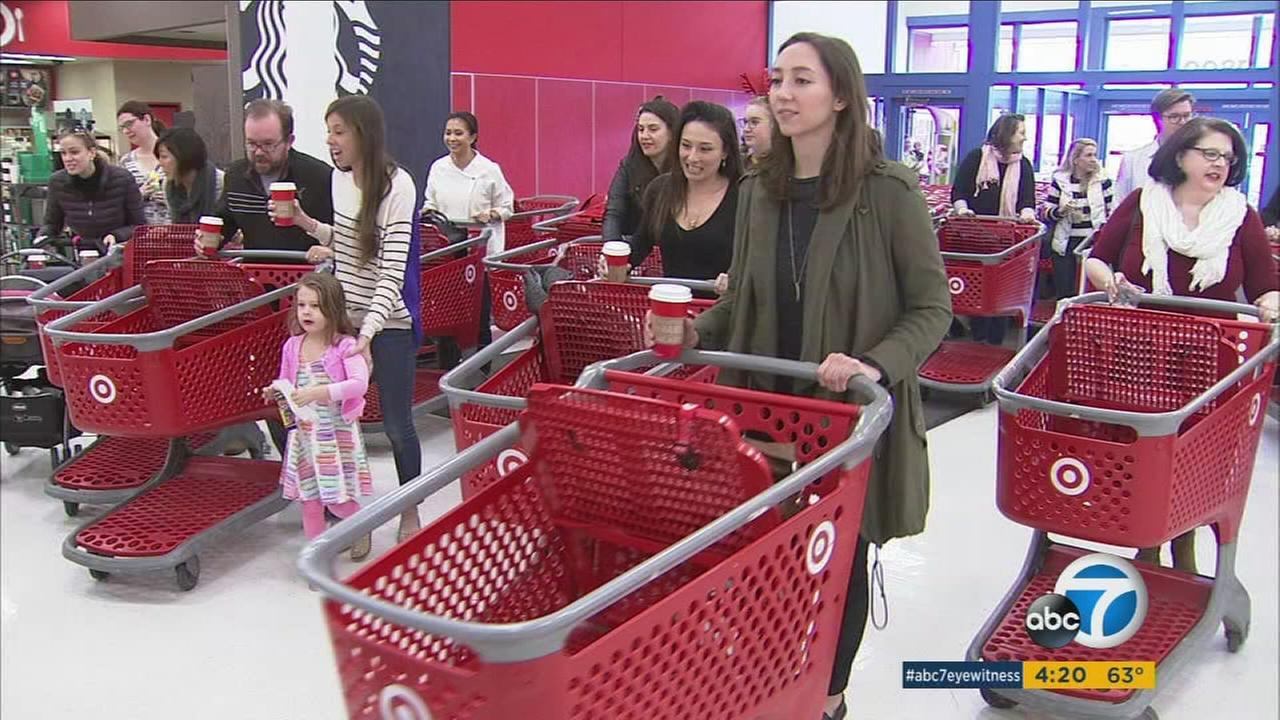 Volunteers pick up presents at Target to be given away to low-income families as part of a Toluca Lake familys holiday giving effort.