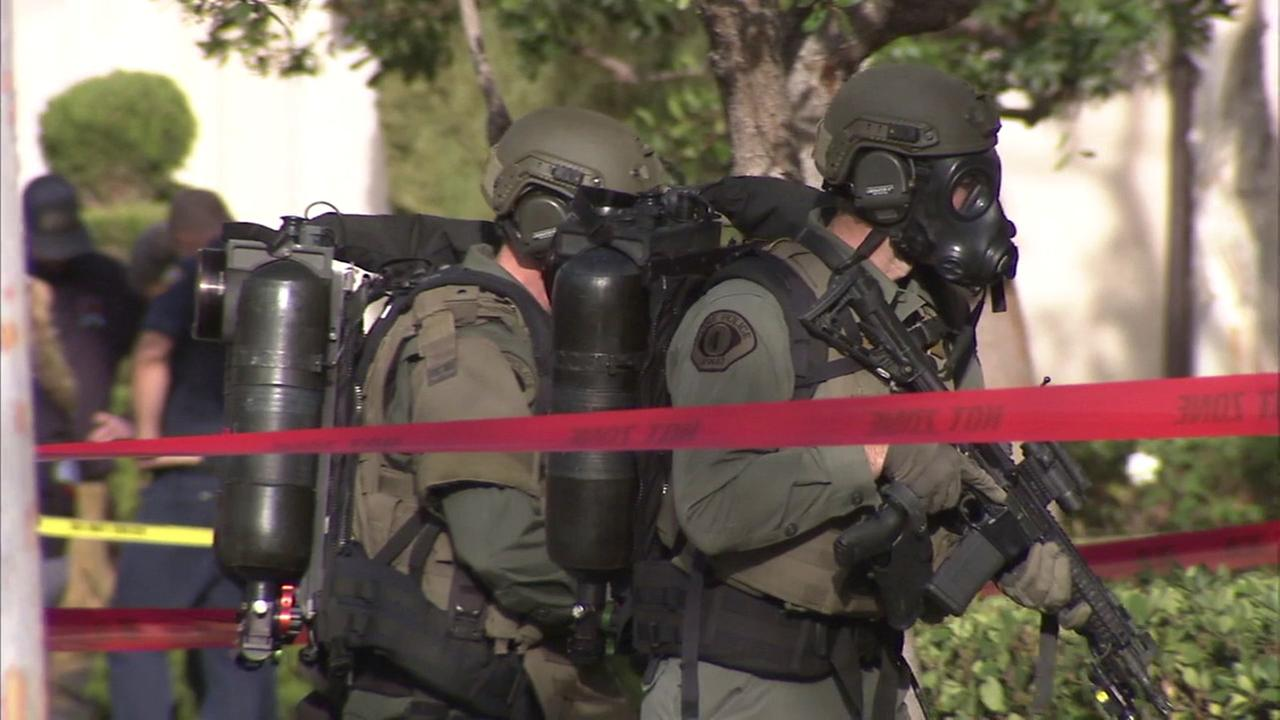 Irvine police officers donned gas masks before searching a home during a hazardous-substance investigation on Tuesday, Dec. 6, 2016.