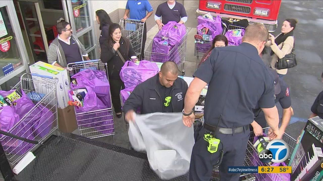 As part of ABC7s Spark of Love toy drive, Fremantle employees took a trip to Toys R Us in Burbank to find toys to donate.
