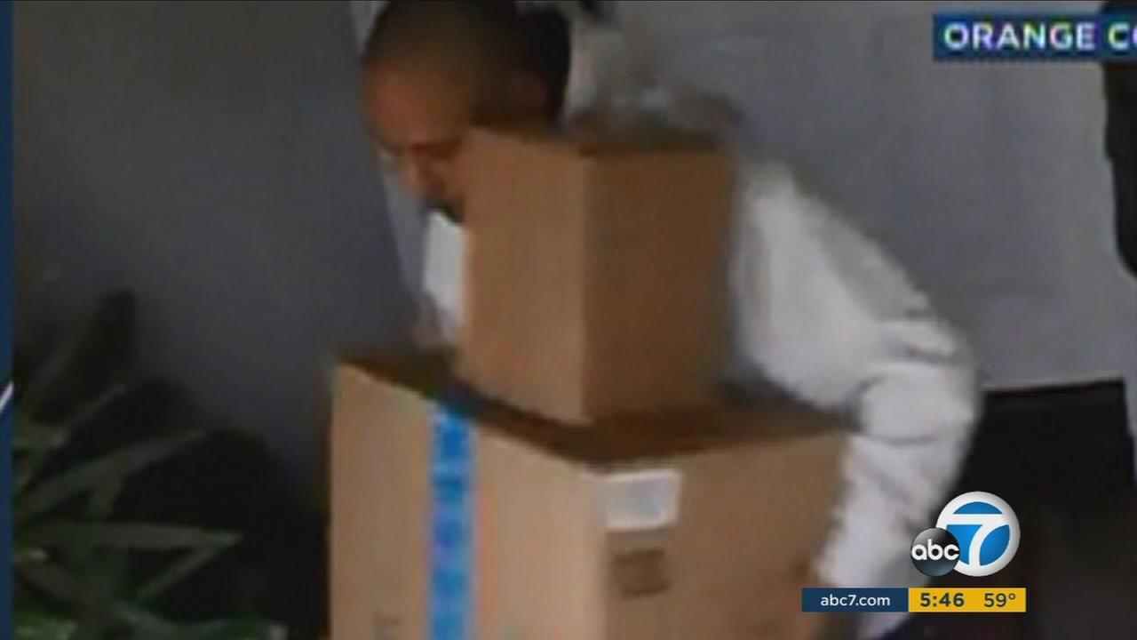 A man is shown on camera walking away with packages that were taken off a Yorba Linda front porch on Nov. 24.