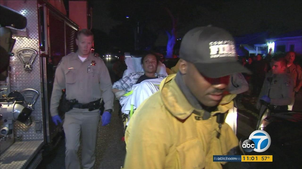 A female suspect was wheeled away in a gurney to be evaluated at a hospital after being Tasered and handcuffed in Compton on Monday, Dec. 12, 2016.