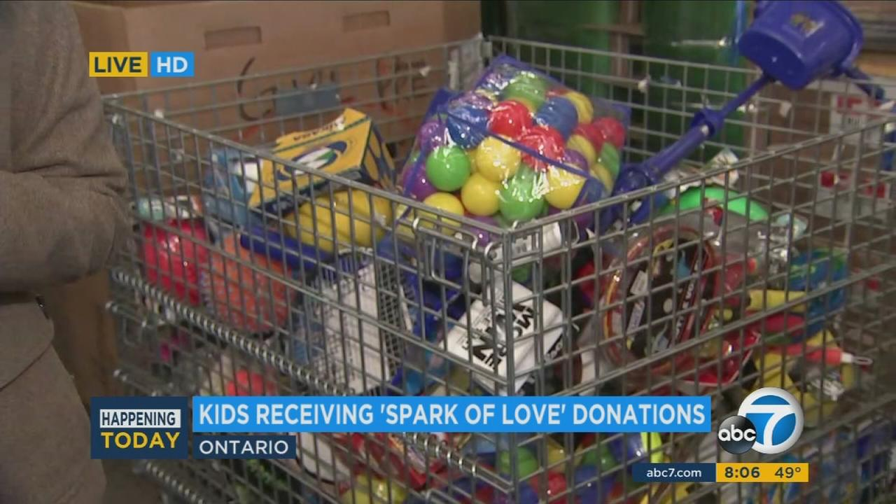 The Spark of Love toy drive began handing out toys for children in need Saturday morning in Ontario, drawing more than 1,000 parents.