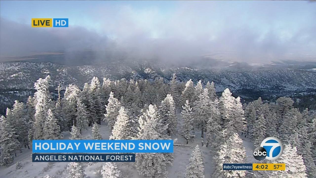 The winter storm that dumped more than an inch of rain on parts of Los Angeles delivered a blanket of snowfall to mountain areas.
