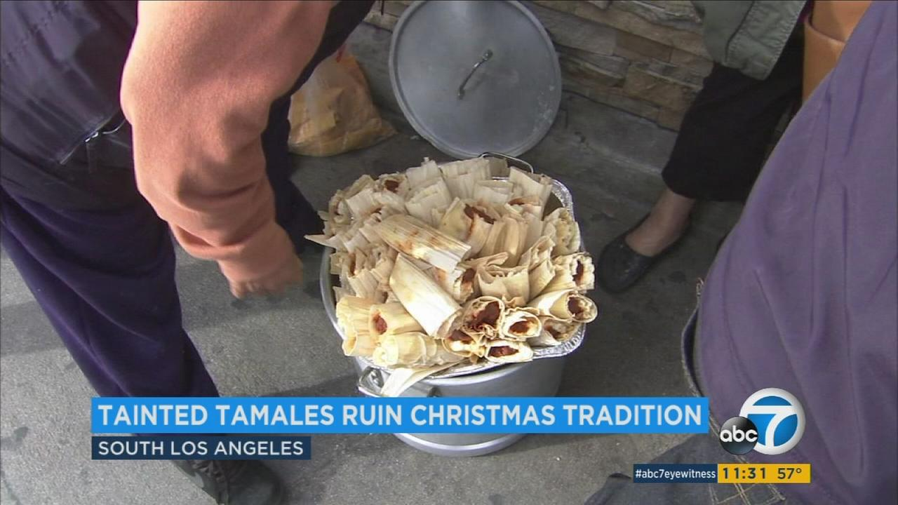 A man held a pot of tainted tamales he was returning to a market in South Los Angeles on Monday, Dec. 26, 2016.