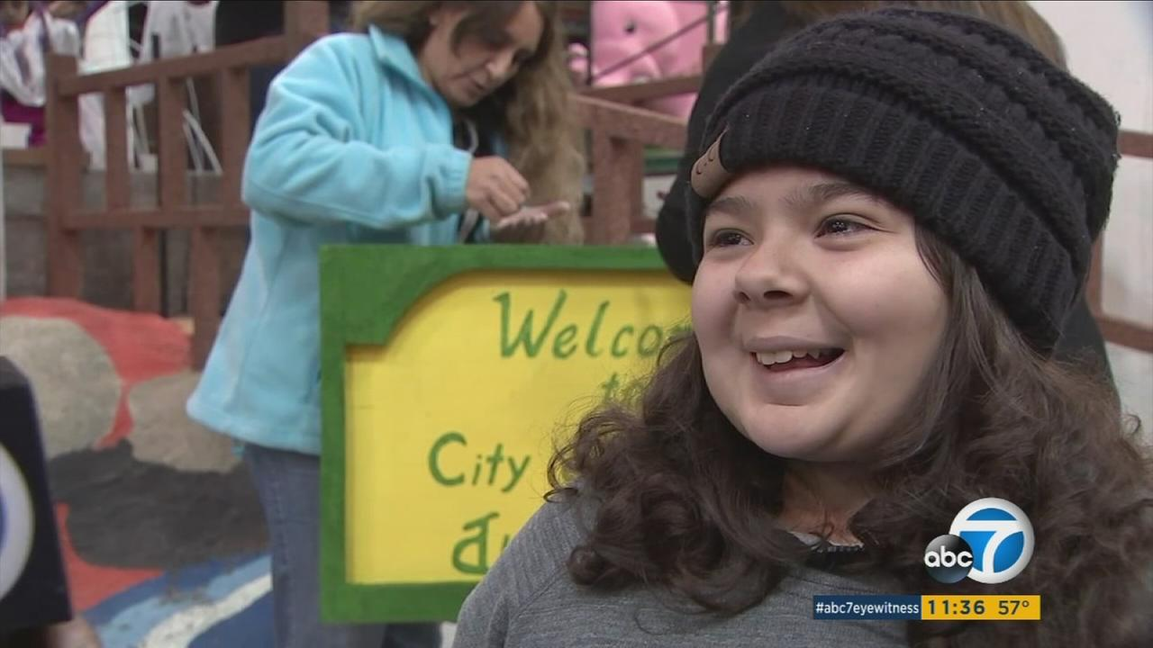 Jackie Garcia, 14, is shown during an interview with ABC7 in Pasadena as she helps put together the City of Hope float on Monday, Dec. 26, 2016.