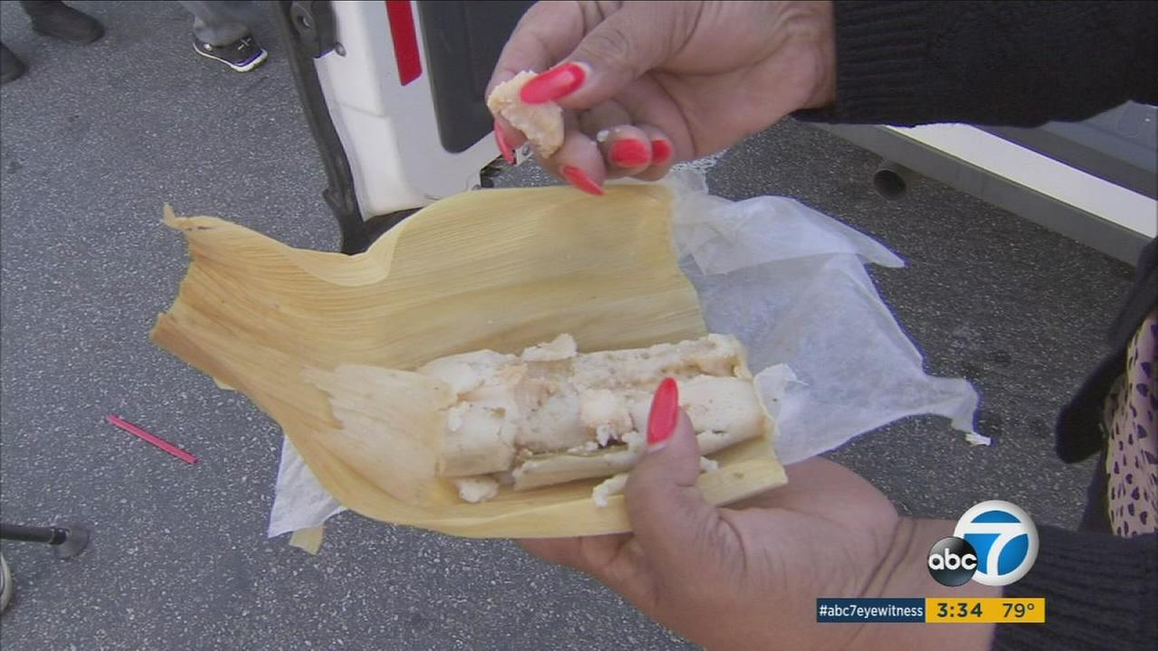 An Amapola customer holds one of hundreds of tamales made with bad masa from the market.
