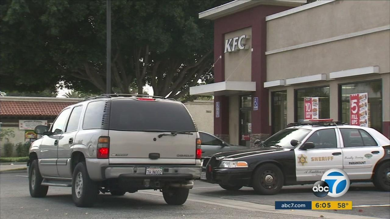 Authorities investigate the scene of an attempted kidnapping at a KFC restaurant in Paramount on Tuesday, Jan. 3, 2017.