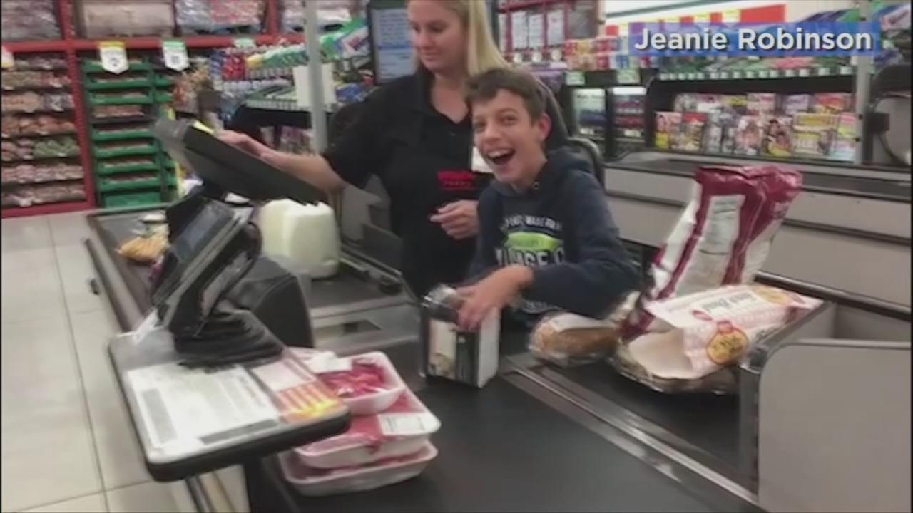 A Temecula cashier made the day of a boy with cerebral palsy when she let him help her scan the items on Friday, Dec. 30, 2016.